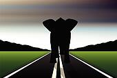 Editable vector silhouette of African elephant in walk pose on a road