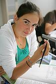 Teenage girl writing in an exam