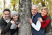 Adult family around a tree