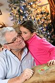 Grandfather and granddaughter at Christmas
