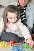 Little girl playing with grandma