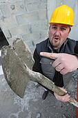 Tradesman pointing to a worn out spade