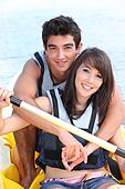 Young couple in a paddle boat