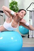 Woman working out on gym ball