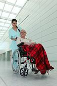 a nurse and an old lady in wheelchair