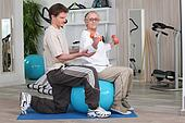 Woman working out with the help of her personal trainer