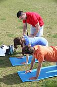 Personal trainer helping his client