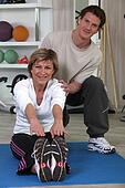 Middle-aged woman with personal trainer