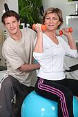Mature woman and trainer in workout