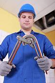 Plumber preparing copper pipe