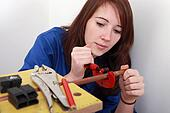red-haired girl working as plumber