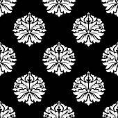 Arabesque pattern of floral motifs on black