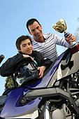Father and son holding a trophy