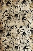 Tattoo pattern with gargoyle designs over antique paper