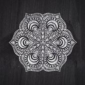 Flower chalk drawing on chalkboard blackboard. Ornamental round lace pattern, circle background with many details, looks like crocheting handmade lace on grunge background, lacy arabesque designs.