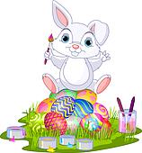 Easter. Bunny sitting on eggs