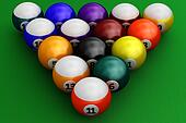 Colorful pool balls over green