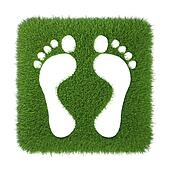 trace of human foot on green grass