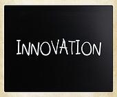 """Innovation"" handwritten with white chalk on a blackboard"