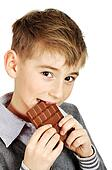boy eating a chocolate bar