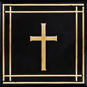 Golden cross, symbol of the Christian faith on the black background
