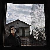 hooded figure threaded window