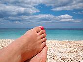 Lazy feet on the beach