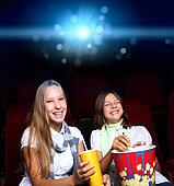 Two young girls in cinema