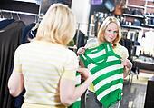 Young woman at shirts clothes shopping
