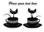 Two black cats sitting in cups