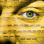 Face with eye showing sheet music