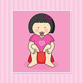Baby girl sitting on the potti
