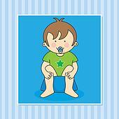 Baby boy sitting on the potty