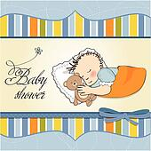 little baby boy sleep with his tedd