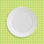 Vector plate on tablecloth