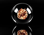 glass sphere with fire ball inside