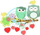 Two cute owls and bird on the flower tree branch