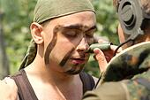 Soldiers putting on face paint