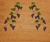 Grape vine on the wood texture background