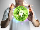 businessman holding green globe