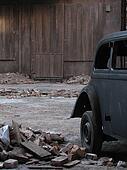 old car beside vintage house