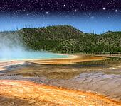 Landscape and Geysers of Yellowstone National Park at Night