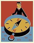 A businessman holding a big compass