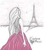 Girl looks at eiffel tower.