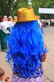 Golden hat on a blue wig of a young