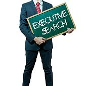 Business man holding board on the background with business word - Executive search
