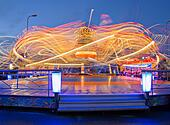Revolving carousel is ride visitors at speed
