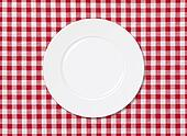 White plate on red and white striped seamless tablecloth