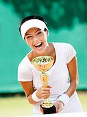 Young female tennis player won the tournament