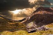 Moody dramatic mountain sunset landscape